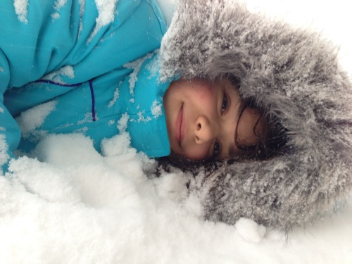 Claire lying in snow